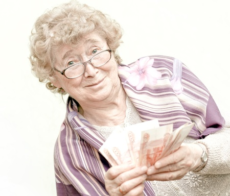 money packs: elderly happy woman with pack of money