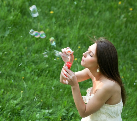 attractive young girl with soap-bubbles photo