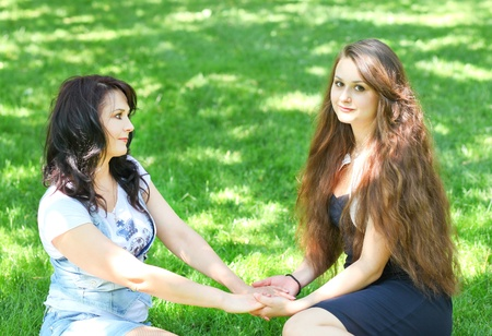 beautiful mother and daughter enjoying in summer green park photo