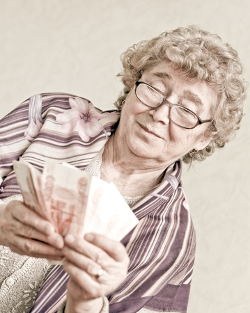 elderly happy woman with pack of money Stock Photo - 10217035