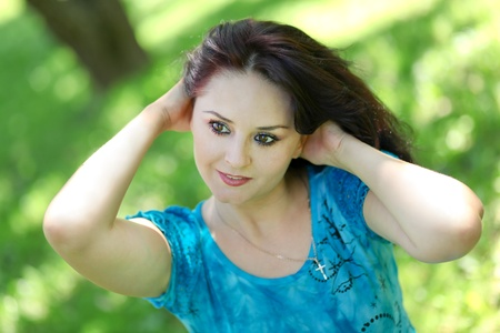 abstract portrait of beautiful young woman relaxing in summer park photo