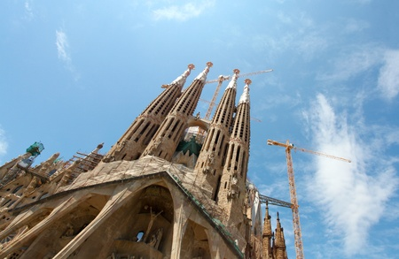 unrealistic: BARCELONA SPAIN - JULY 25: La Sagrada Familia, the unrealistic cathedral designed by Gaudi, which is being build since 19 March 1882 with the donations of people, on July 25, 2011 in Barcelona, Spain Editorial