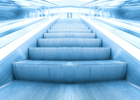 blue escalator in business hall photo