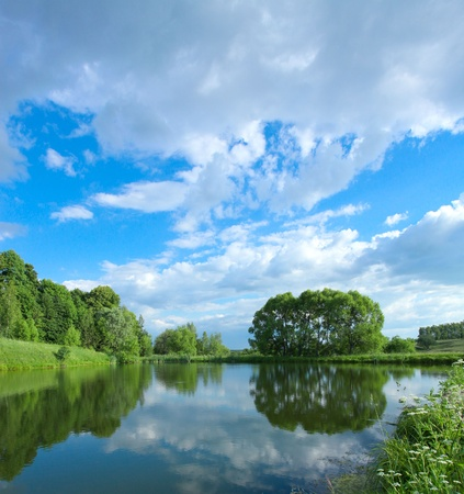 hillock: picturesque scene of beautiful rural lake