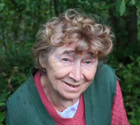 portrait of a nice aged woman at nature Stock Photo - 10508082