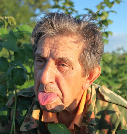 Funny elderly man with tongue outdoor Stock Photo - 10501762