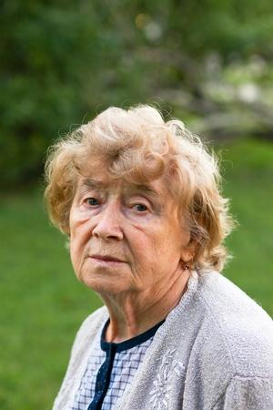 Portrait of a sad senior woman outdoor