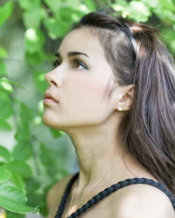 woman profile face: Portrait of beautiful cute young girl yearning in leafage outdoor