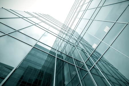 tilt: glassy texture of tilt view to contemporary turquoise glass business center Stock Photo