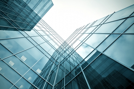 office building exterior: slippery texture of glass high-rise building Stock Photo