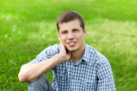 happy young man: handsome smiling young man enjoying in nature