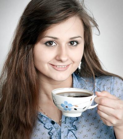 Beautiful brunette lady drinking bracing coffee photo