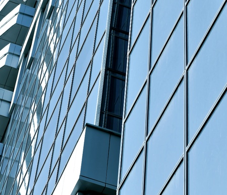 underside: glass surface of contemporary angle of business building Stock Photo