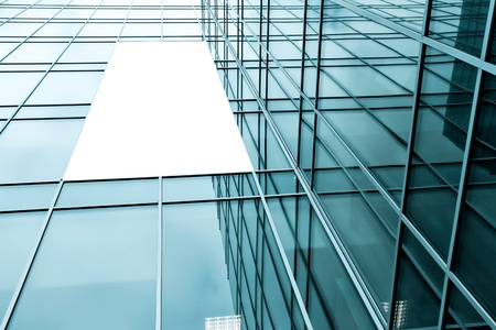 blue glass wall with blank placard of skyscraper photo