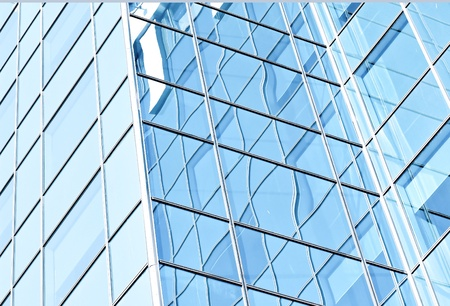 tilt: turquoise contemporary glassy texture of modern buildings pane Stock Photo