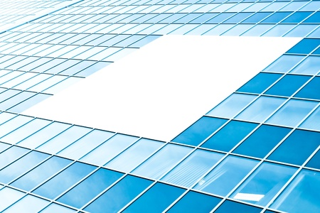 blank center: blank billboard over glassy building texture Stock Photo
