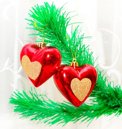 new year  s day: Red hearts hanging on Christmas fir tree