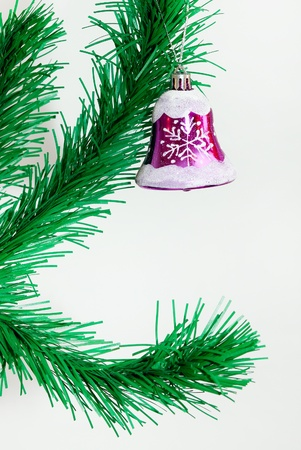 Branch of Christmas tree with colorful bauble hanging photo