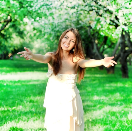 beautiful young woman in nature photo