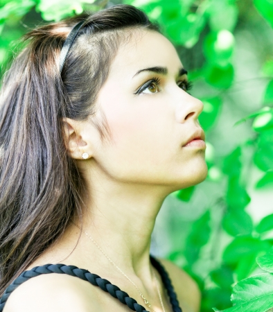 leafage: Portrait of beautiful cute young girl yearning in leafage outdoor