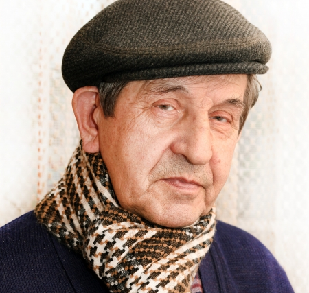 head wear: Mature man with hat and scarf outdoor Stock Photo