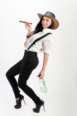 sexy woman with cigar and glass bottle half full of alcohol photo
