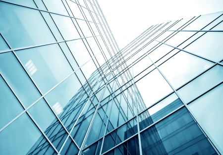solid blue background: glassy texture of tilt view to contemporary turquoise glass business center Stock Photo