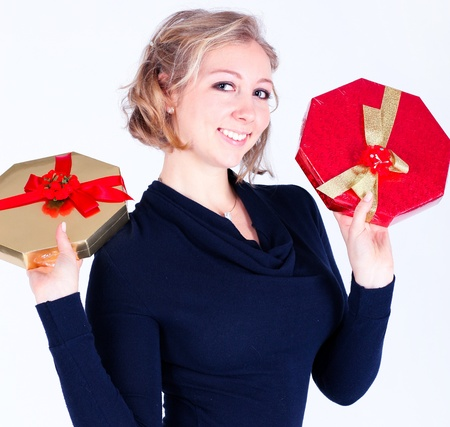 attractive young girl with christmas vivid presents Stock Photo - 17574947