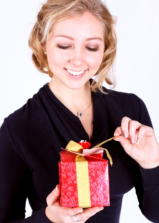 attractive young girl with christmas vivid presents Stock Photo - 17574951