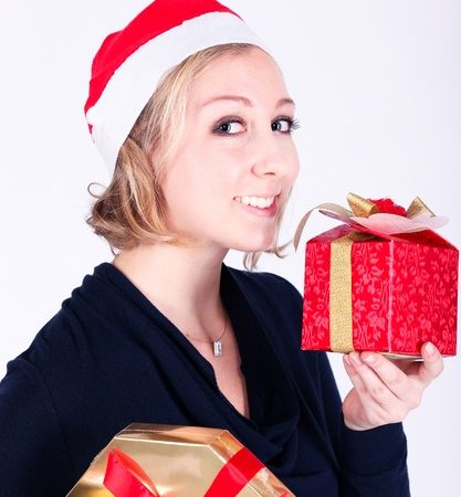 attractive young girl with christmas vivid presents photo