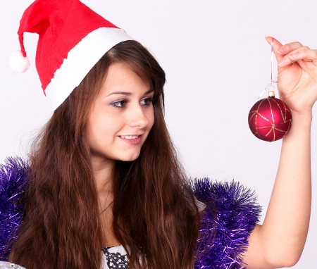 attractive young girl with christmas presents wondering photo