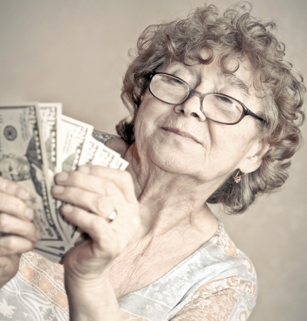 desirable: senior happy woman with money Stock Photo