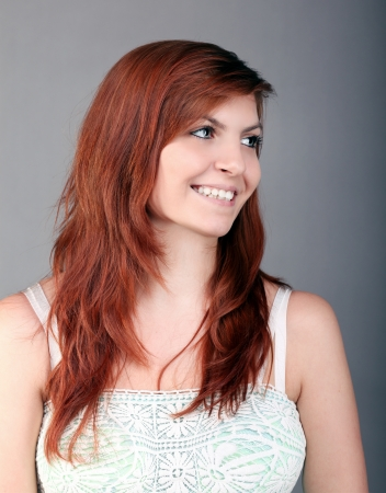 redhaired: young happy woman with beautiful brown hair