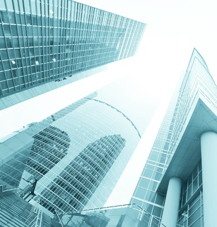 property management: low angle view to blue contemporary glass skyscraprs