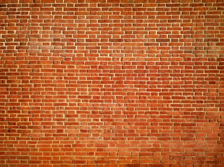 brick wall background: The old vintage dark brick wall background