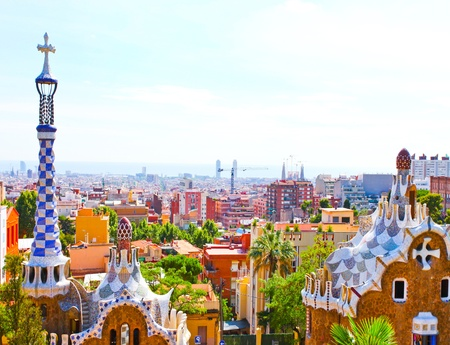 guell: The Famous Summer Park Guell over bright blue sky in Barcelona, Spain Stock Photo