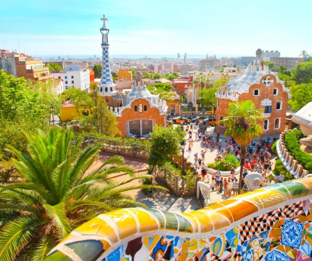 guell: The Famous Summer Park Guell over bright blue sky in Barcelona, Spain Editorial