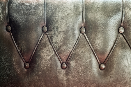 Luxury and grungy background of classic shabby brown texture in old door with metal buttons photo