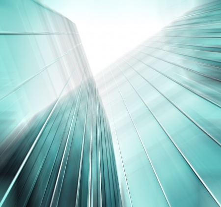 white abstract: Panoramic and perspective wide angle view to steel blue background of glass high rise building skyscrapers in modern futuristic downtown at night Business concept of successful industrial architecture Stock Photo