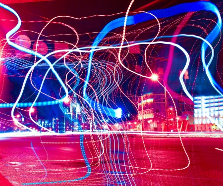 Colorful ribbons over night streets
