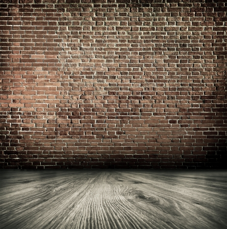Empty black old spacious room with stone grungy wall and wooden weathered dirty floor, vintage background texture of brickwall