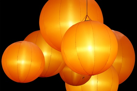 warmly colored balloon lamps isolated on black background  photo