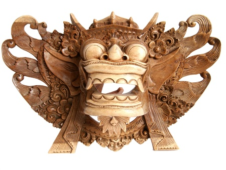 Traditional Indonesian (Balinese) mask-souvenir from a tree isolated on white background