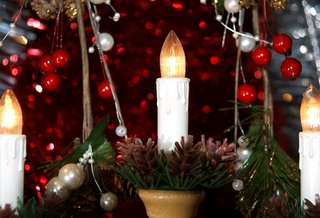 New Years electric candles on the background of Christmas decorations photo