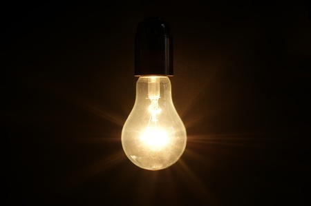 Large brushed electric incandescent lamps, against a dark background Stock Photo