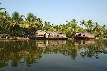 House boat in the Kerala (India) Backwaters. Used to carry rice in the olden days. Now primarily used as houseboats.  photo