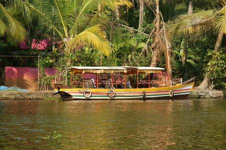 Boat on forest lake, Periyar National Park, Kerala, India photo