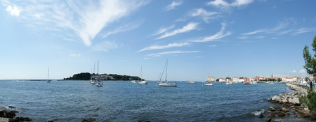 panoramic landscape of the sea with yachts and the city of Porec, Croatia photo