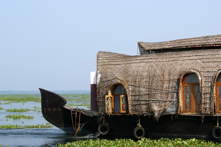 primarily: House boat in the Kerala (India) Backwaters. Used to carry rice in the olden days. Now primarily used as houseboats.