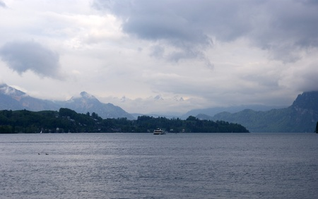 view of a wooden doorway: Lucerne, Switzerland, view of Lake Lucerne in dull cloudy weather Stock Photo